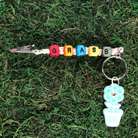 HOTI Hemp Handmade Grass Natural Hemp Keychain Key Chain Wood Cube Square Alphabet Beads Multi Colour Red Turquoise Blue Yellow Green Orange Word Up Roach Clip Made in Canada Hand Crafted Made in Toronto Made in Ontario Beaded Cannabis Accessory Weed Pot Marijuana Mary Jane Accessories Dope 420 Stoner Gift Clip-It Alligator Clip Canadian Clip Toronto Ontario Canada