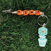 HOTI Hemp Handmade HEMP Natural Hemp Keychain Key Chain Wood Cube Square Orange Alphabet Beads Word Up Roach Clip Made in Canada Hand Crafted Made in Toronto Made in Ontario Beaded Weed Pot Accessory Cannabis Marijuana Pot Accessories Dope Stoner Gift Mary Jane 420 Clip-It Alligator Clip Canadian Toronto Ontario Canada