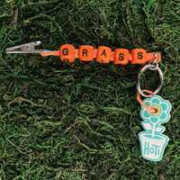 HOTI Hemp Handmade Grass Orange Hemp Keychain Key Chain Wood Cube Square Alphabet Beads Word Up Roach Clip Made in Canada Hand Crafted Made in Toronto Made in Ontario Beaded Cannabis Accessory Weed Pot Marijuana Mary Jane Accessories Dope 420 Stoner Gift Clip-It Alligator Clip Canadian Clip Toronto Ontario Canada