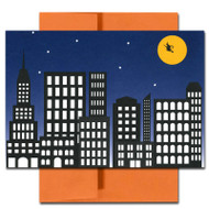 Cover of City Witch Halloween Card showing witch flying across a yellow moon over city buildings