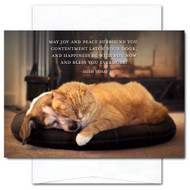 "New Year's Card: Joy and Peace shows a dog and cat sleeping in front of a fire with the quote: ""May joy and peace surround you, contentment latch your door, and happiness be with you now and bless you evermore."""